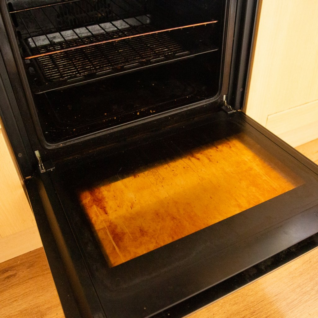 open oven with dirty window
