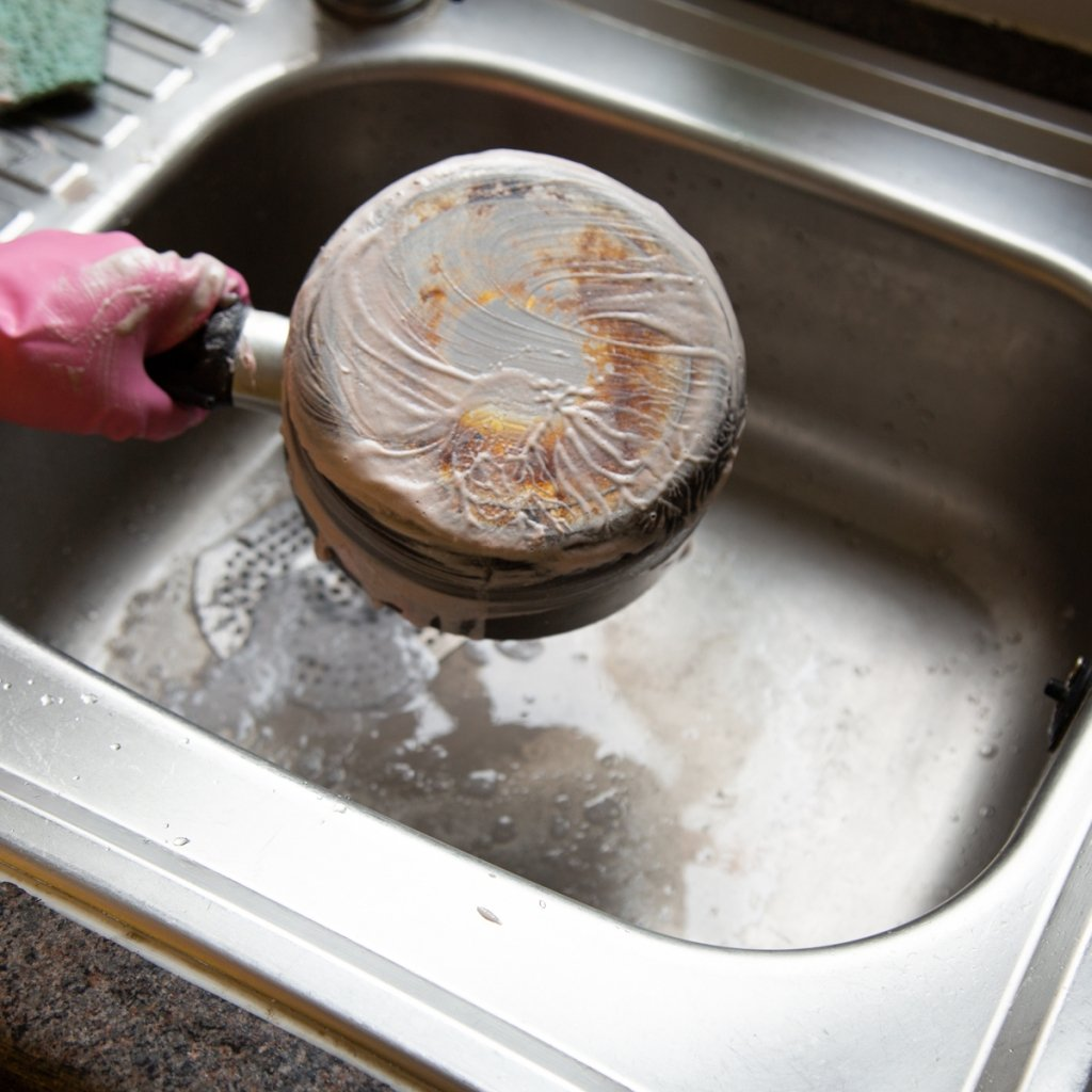 pan over sink with the pink stuff paste on it