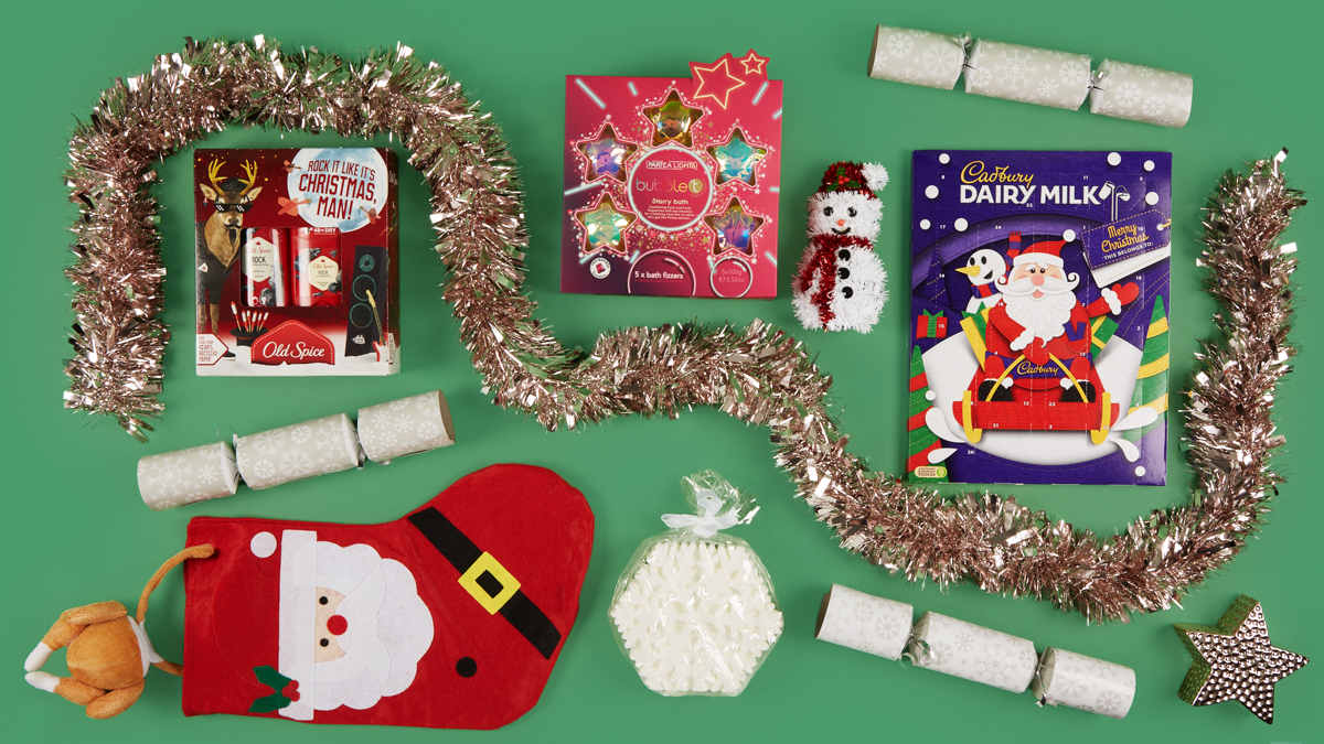 christmas decorations and gifts on green background